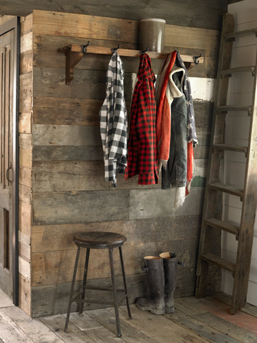 boots in a mudroom foyer with reclaimed wood walls 