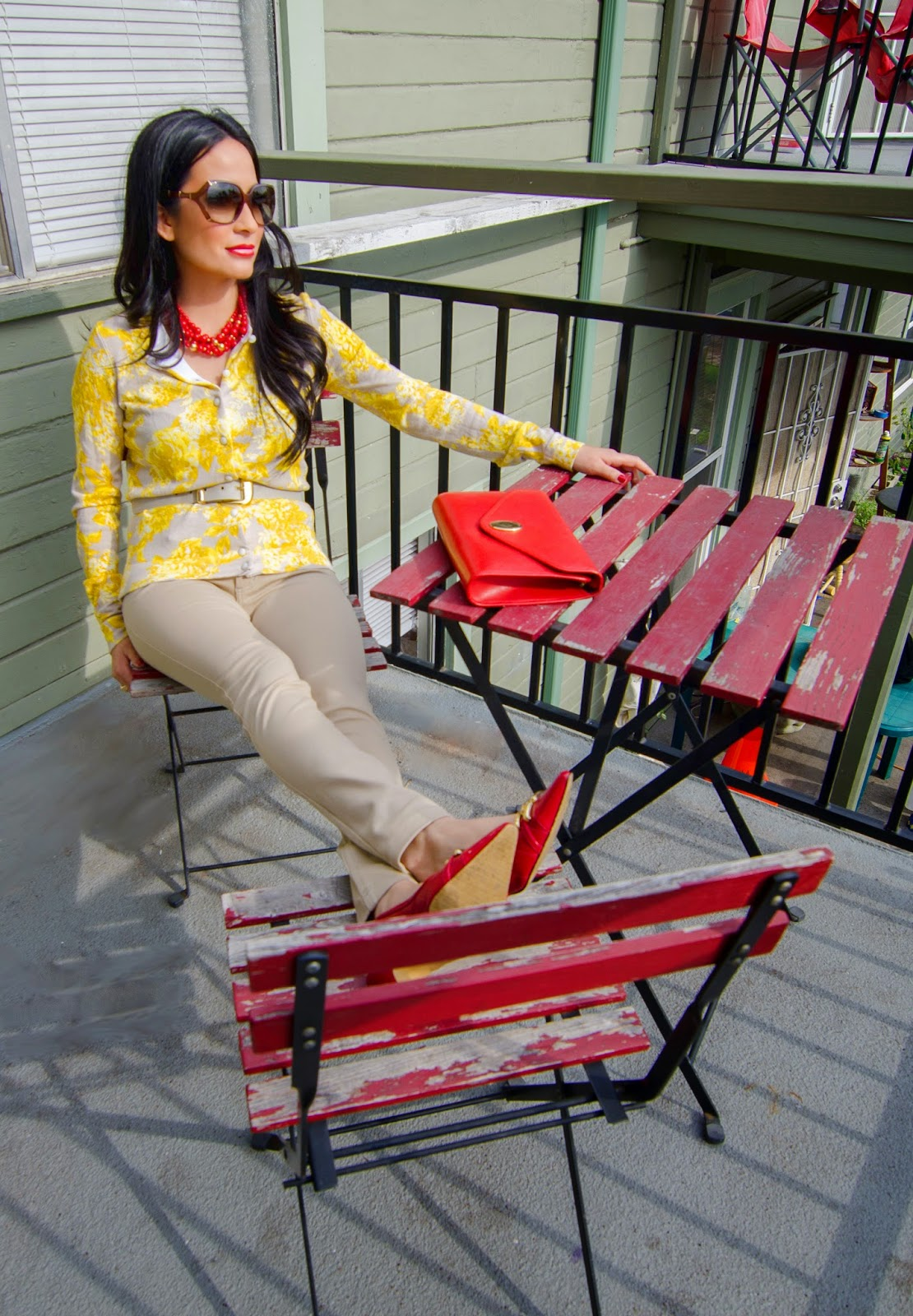 red and yellow sweater Gucci sunglasses Christian Dior purse