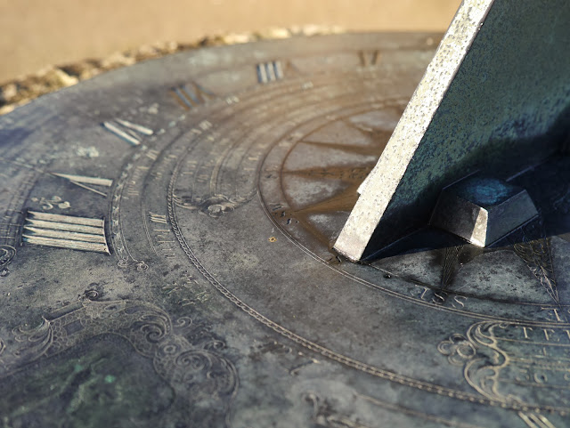 A close-up of a sundial