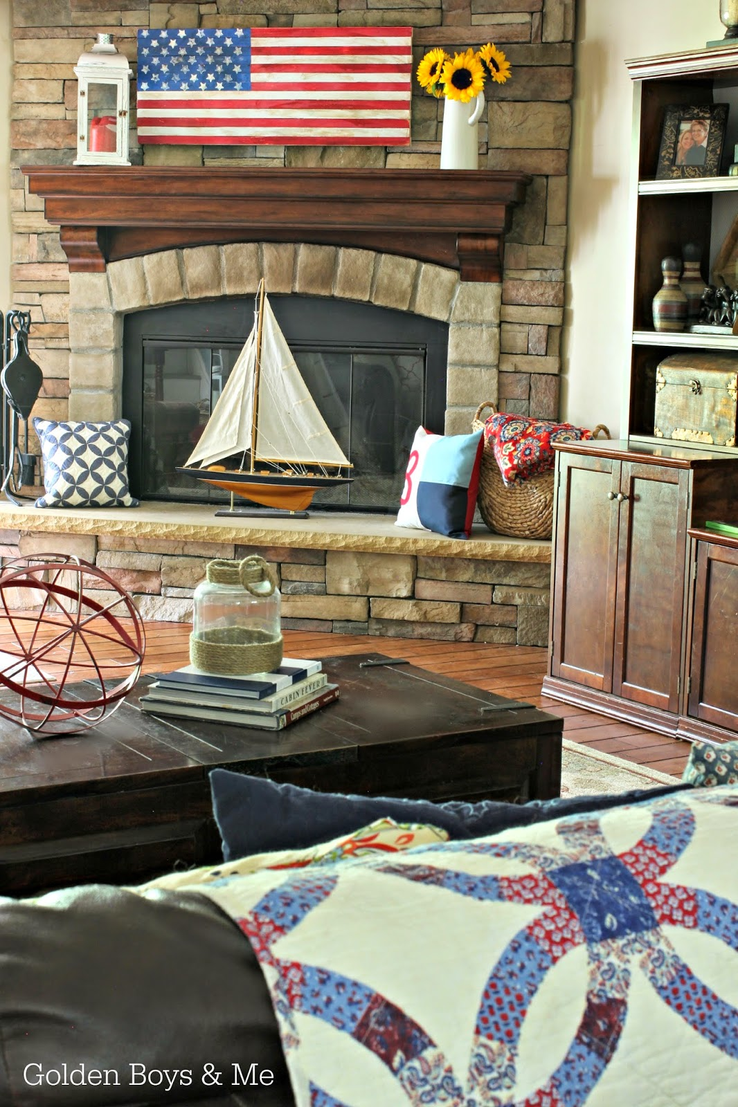Americana family room with diy wooden flag and stone fireplace-www.goldenboysandme.com