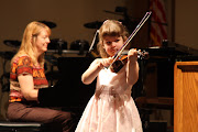 Evie is the daughter of our violin instructor, Ms. Bethany, and she always .