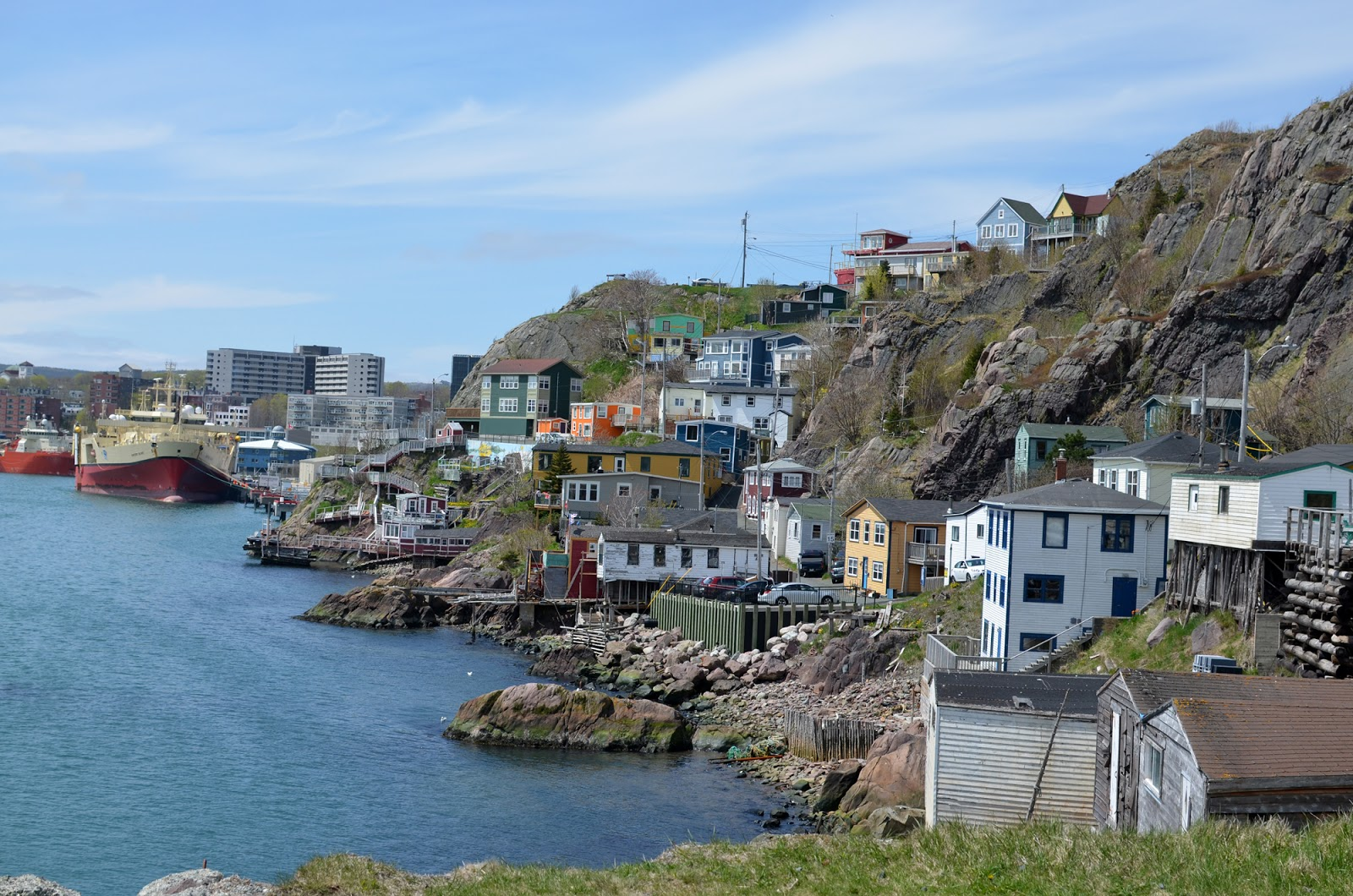 Colourful houses along the shoreline at Signal Hill in St. John's