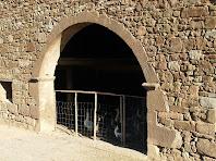 Detall de l'arc de la pallissa de Postius