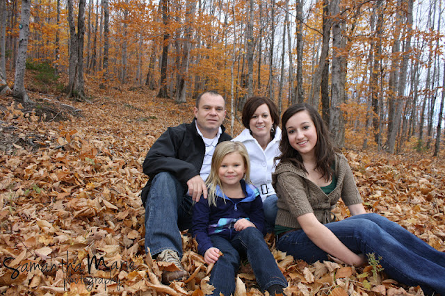 family of four in the fall leaves