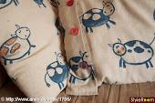 tegn på sengetøj med tekstil tusser