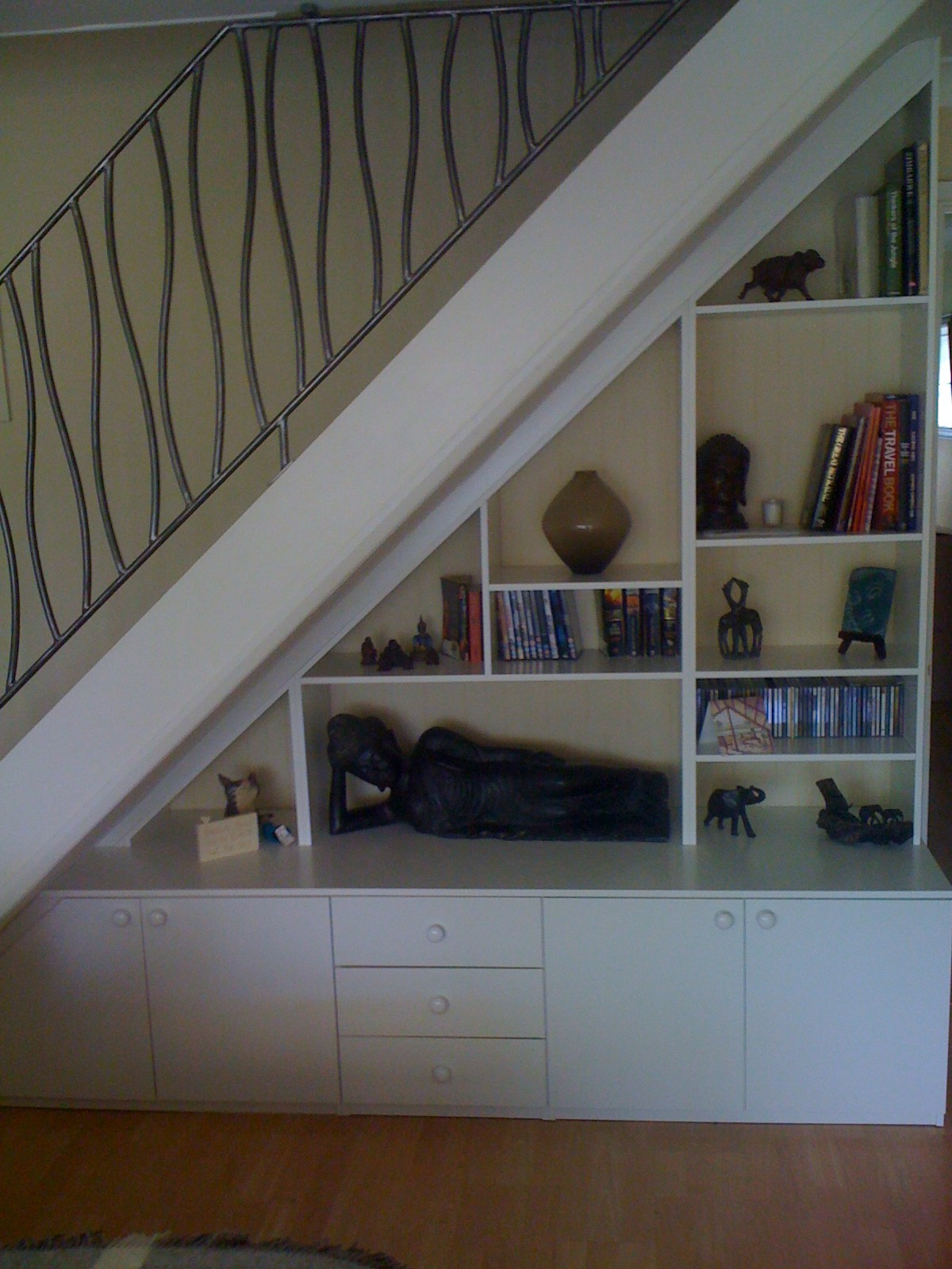 Bespoke fitted shelving furniture making use of space in for Using space under stairs