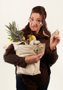 Women with groceries and money