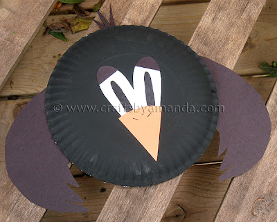 baby making toys: paper plate crow tutorial