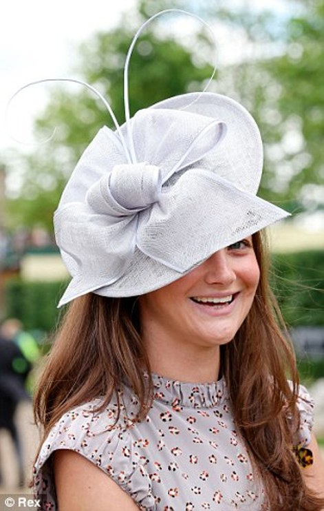 elegant lady in grey outfit with bow hat on day 2 at Royal Ascot 2014
