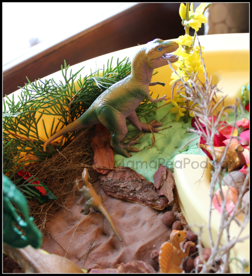 fun dinosaur world play from play dough and nature items from the garden