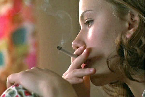 young Scarlett Johansson smoking