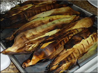 grilled corn on the cob ready to be husked