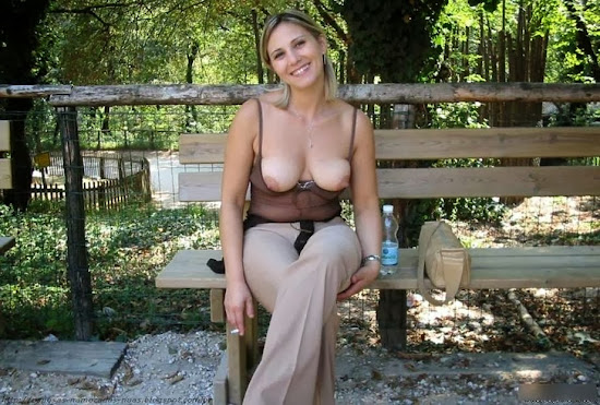 blond milf flashing her saggy tits in public area