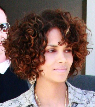 Short layered bob hairstyles in naturally curly hair.