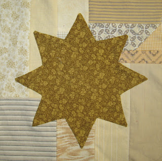 appliqued star on scrappy backgrounds
