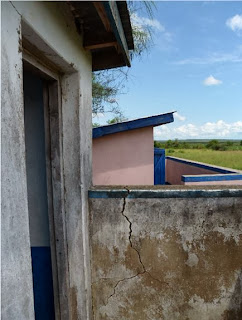 Latrine cemetery under works in a rural school somewhere near Mombasa.