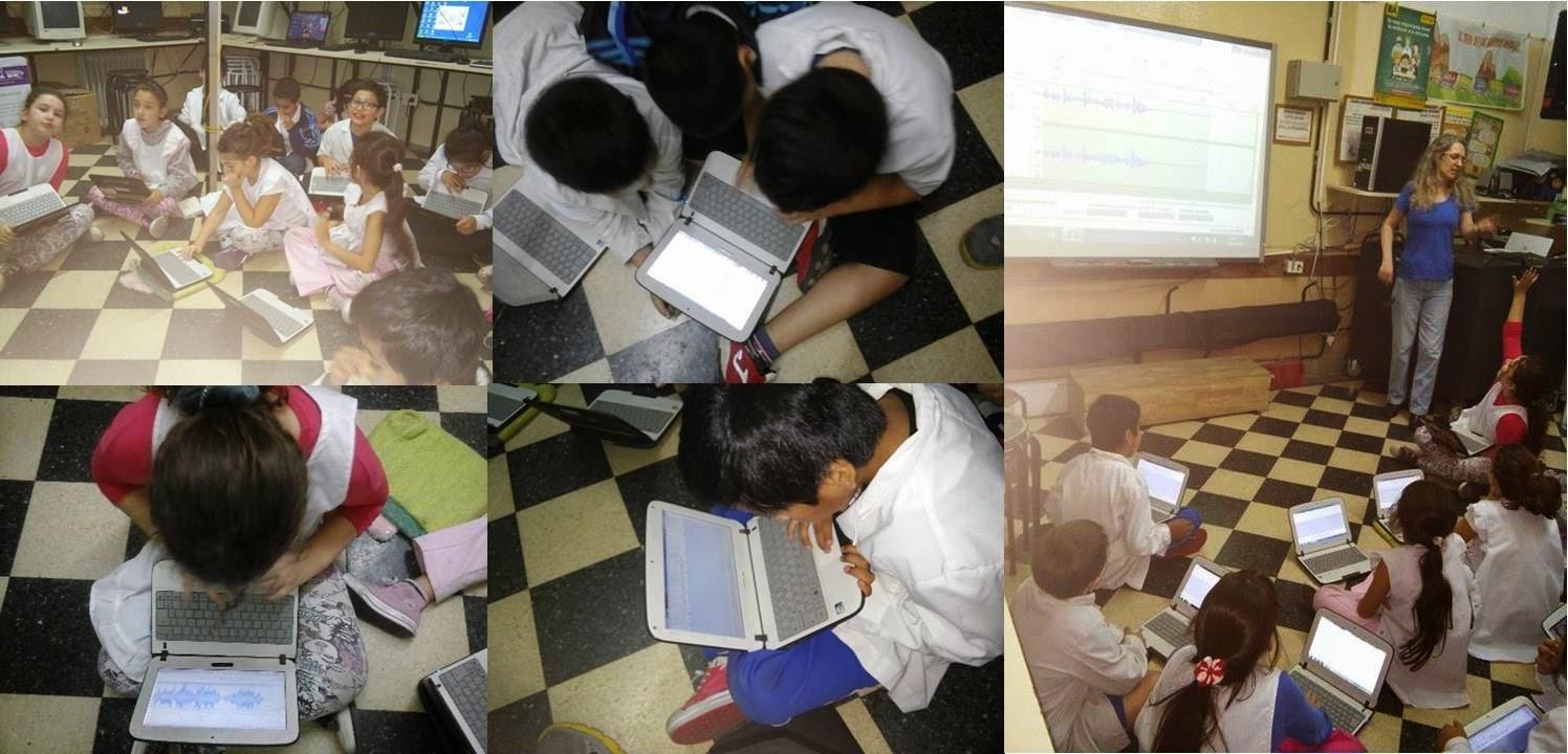 Imágenes de los alumnos trabajando con las netbooks escolares grabando con el programa audacity