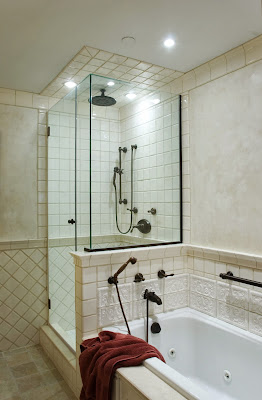 simple white bathroom includes shower glass room and bathtub