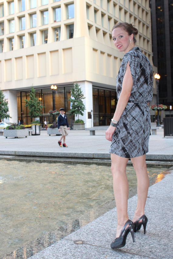 rear view blurry plaid dolman sleeve drop waist dress with gray pumps