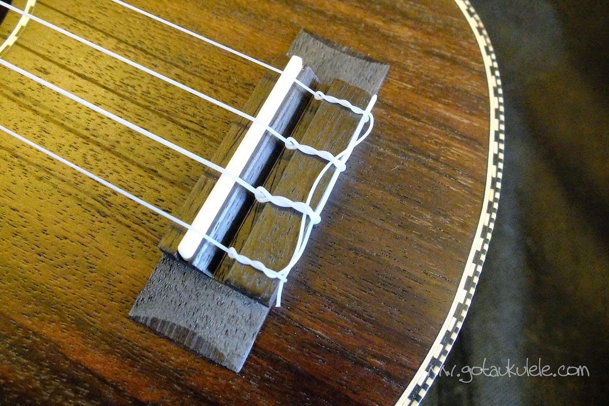 Snail UKS-220 Rosewood Soprano ukulele bridge