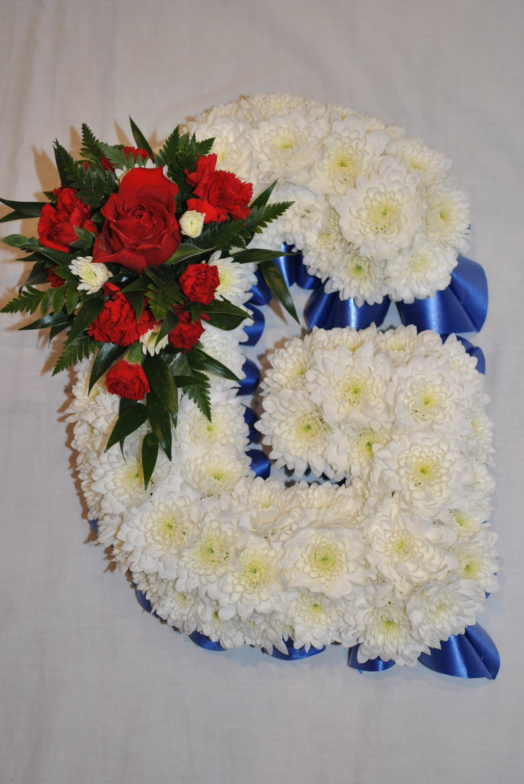 Lucys flower studio letter g for graham pressler grahams funeral flowers in the colours of his favourite football team blackburn rovers izmirmasajfo Images