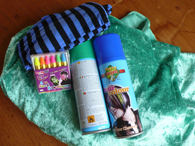 Coloured hairspray, face paints, green fabric and some stripy tights.