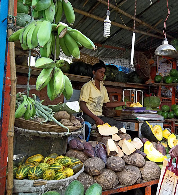vegetable vendor selling raw banannas