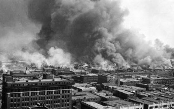"Apparently the security guard didn't know that whites have been ""rioting and scaring blacks"" for quite a long time now.  This is what 'Black Wall Street"" (Oklahoma) looked like after hundreds of jealous whites destroyed it. About 9000 blacks  were left homeless."