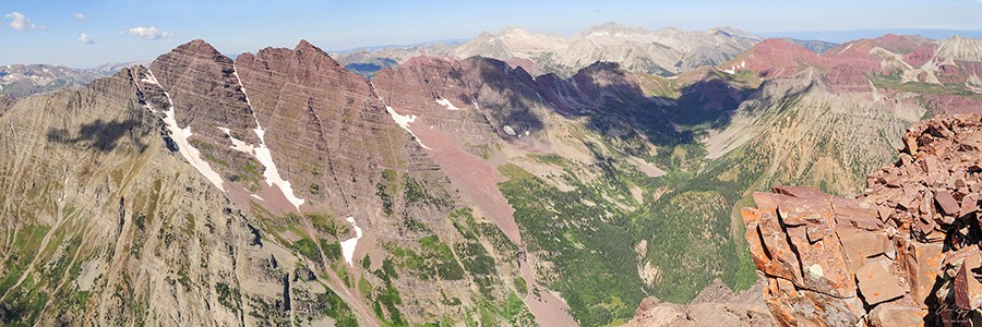 Panorama from the summit of Colorado 14er Pyramid Peak with Maroon Bells Capitol and Snowmass Mountain