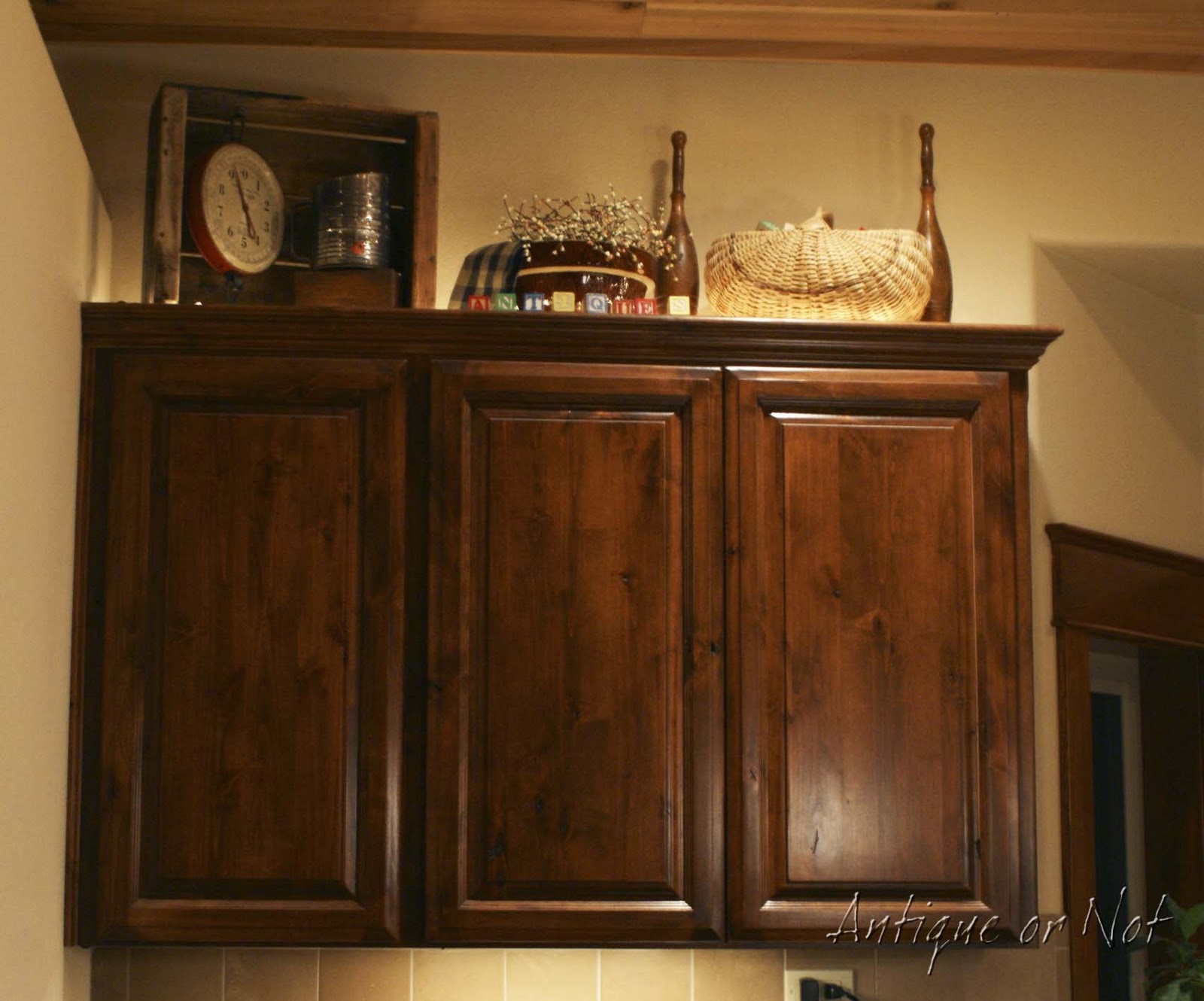 Antique or not decorating above your cabinets How to decorate the top of your kitchen cabinets