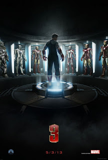 Movie poster showing Tony Stark standing in front of 7 Iron Man suits