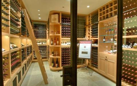 wine cellar with liquor bottles in san franciscos villa belvedere mansion