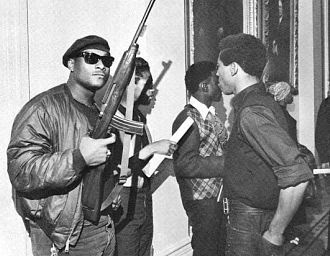 Stokely Carmichael Kwame Ture black panther party holding assault rifle