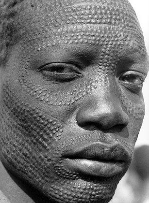 Nuer man from Sudan with tribal scarification