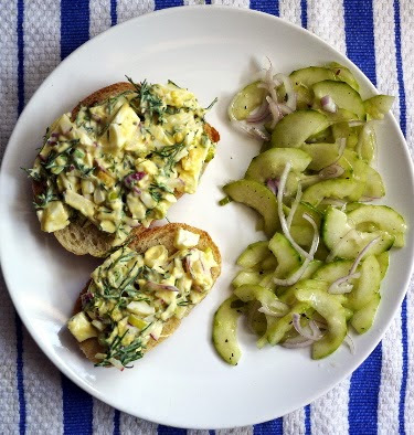 egg salad sandwich with cucumber shallot salad