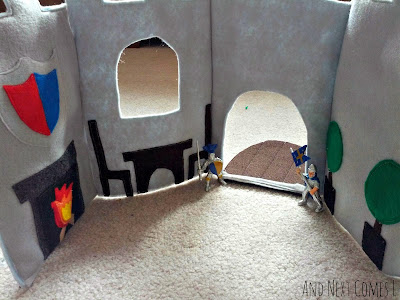 The inside of a homemade felt castle play tote from And Next Comes L