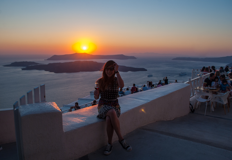 image of the sunset and having wine on the patio of santorini santo wines
