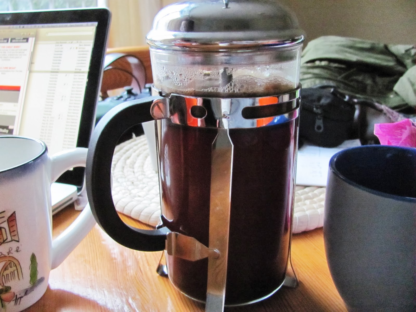 A cafetiere French press coffee maker is full on the table in Dublin, Ireland