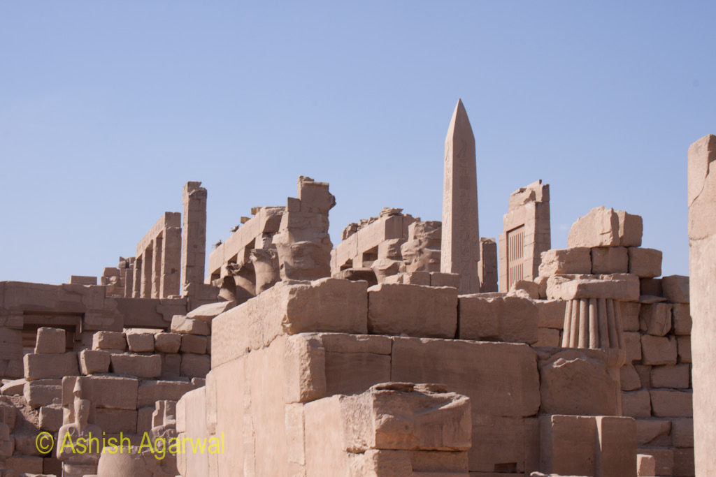 The obelisk rising above some of the other structures inside the Karnak temple