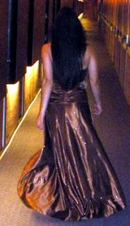 Petite brunette Latina in a brown gown