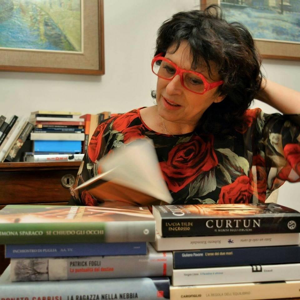 Maria tra i suoi libri