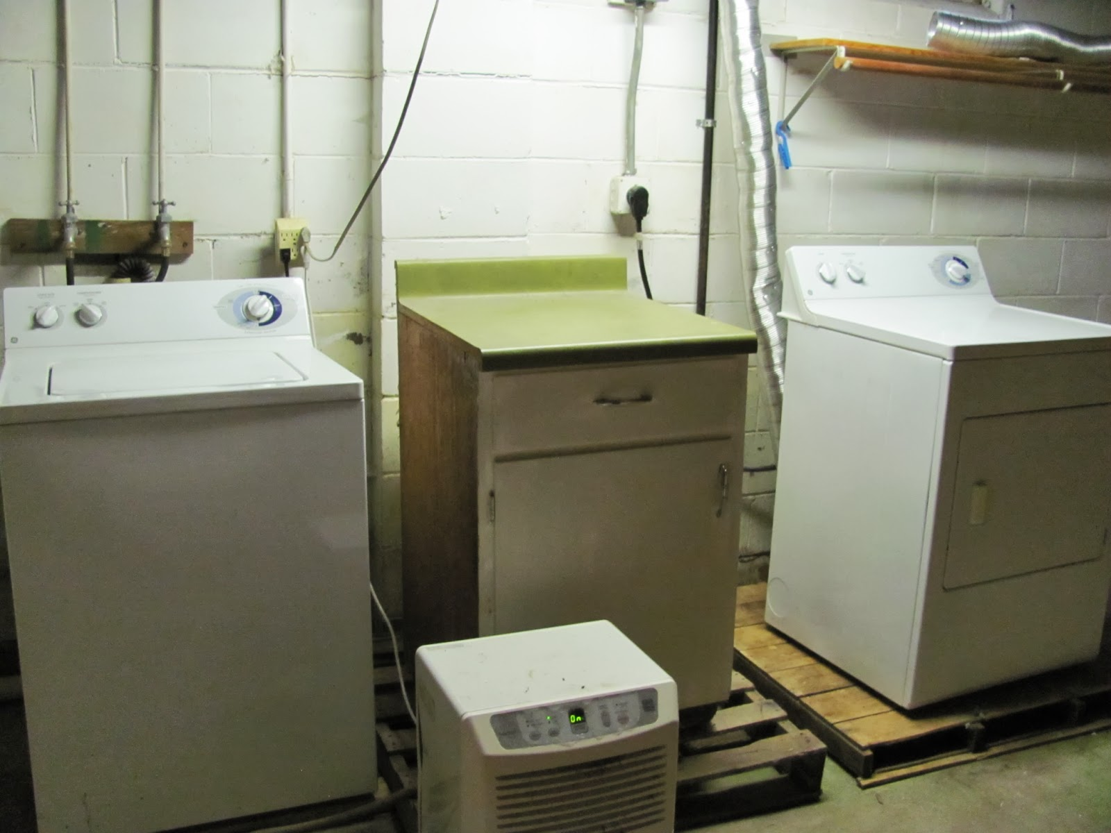 Whirlpool washer and dryer set in the basement
