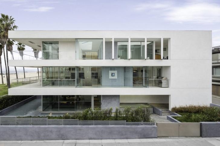 Side facade on Modern mansion on the beach by Dan Brunn