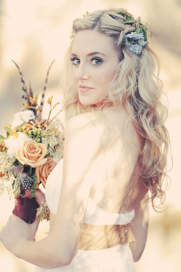simple long curly wedding hair down with floral accessories