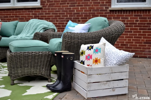 More details on the new patio include these amazing patterned throw pillows and this cute vintage crate to keep them in.
