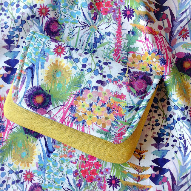 Handmade clutch purse made using Liberty Tresco print and mustard linen