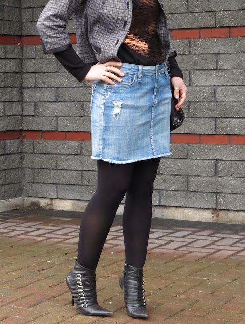 denim cut-off skirt, sequinned sweater, Chanel-inspired jacket, black tights, and bebe booties
