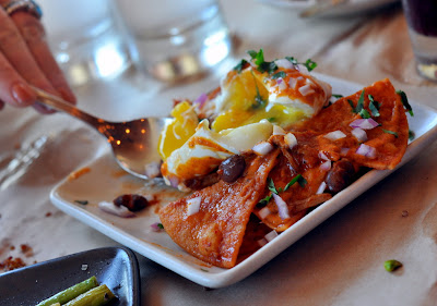 Chilaquiles with Braised Pork and Poached Egg at Zuzu in Napa, CA - Photo by Taste As You Go