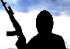symbolic photo of militant with deadly firearm in hand