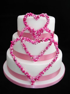White Round Wedding Cakes Decorated with Heart Shape Small Pink Balls